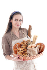 Pretty woman holding a tray with bread products.