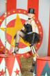 Beautiful circus performer in a black top hat and tutu