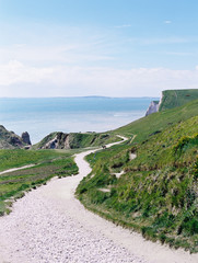 A winding path along the cliffs, a coastal walk.