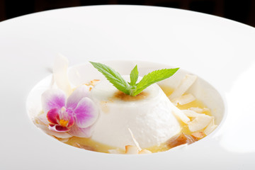 Coconut panna cotta with sour mango and date purée