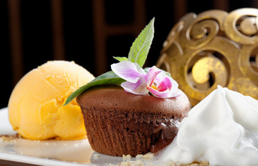Fine dining, Chocolate souffle with mango ice cream and coconut