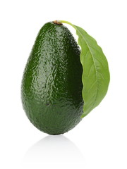 Avocado with leaf stands upright vertically isolated on white