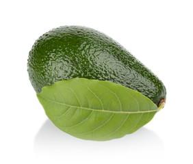 Avocado with leaf lies horizontally isolated on white