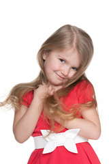 Funny little girl in the red dress