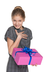 Happy girl holds a gift box