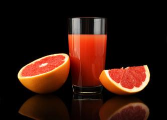 Studio shot sliced three grapefruits with juice isolated black