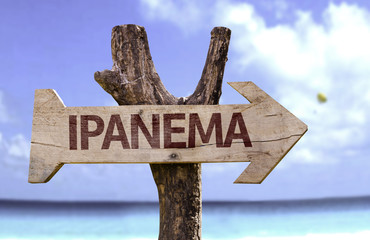 Ipanema wooden sign with a beach on background
