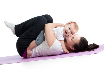 mother with baby do gymnastic and fitness exercises