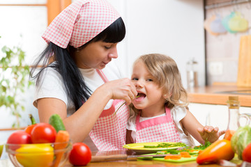 child and mother on kitchen