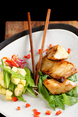 Fried black cod with soy sauce and potato salad - asian style