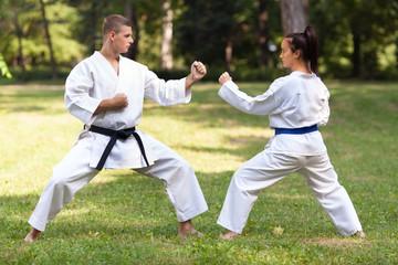 oman doing Gyaku-tsuki exercise with her instructor