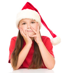 Young unhappy girl in christmas cloth