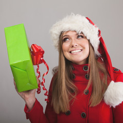 Young beautiful woman with a holiday gift