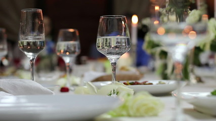 wineglasses with soda water on the festive table