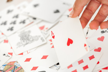 Woman hand holding an ace of heart