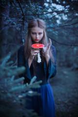 beautiful witch holding a mushroom
