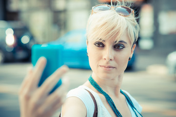 beautiful young blonde short hair hipster woman selfie