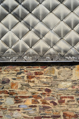 Part of facade cased in sidings tile work of fibre cement