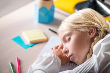 Sleeping school girl in classroom