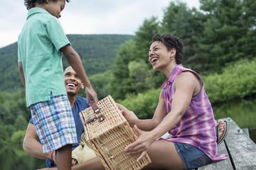 A family having a summer picnic at a lake.