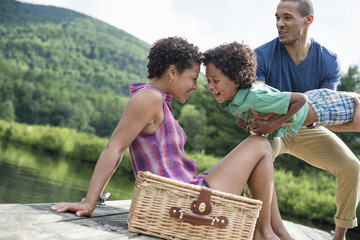 A family having a summer picnic at a lake.