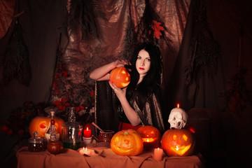 witch with halloween pumpkin indoor