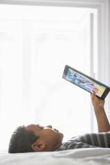 Boy using a tablet.