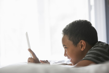 Boy using a tablet.