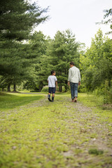 Two brothers walking on a country path.