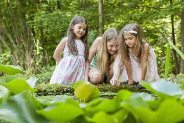 Three girls playing outdoors.
