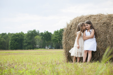 Two girls playing outdoors.