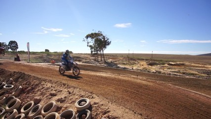 Low Aerial of Dirt Bikes and ATV on Track