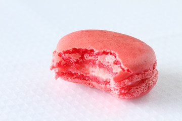 bitten french macaroons on white background