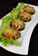 Warm appetizer of eggplant under cheese