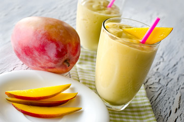 Healthy mango tropical smoothie horizontal