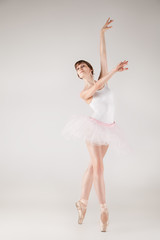 Ballet dancer in white tutu posing