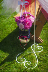 round aster bouquet hanging on stand