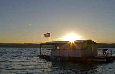 houseboat at sunset