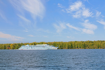 Cruise ship on the Volga river in autumn sunny day, Russia