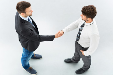 Business associates shaking hands, high angle view