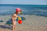 funny baby in sea water