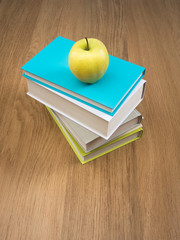 Pile of books with apple