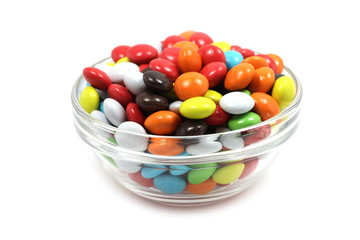 chocolate balls in colored icing in a glass