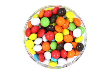 Chocolate candy in a colored glaze on a white background