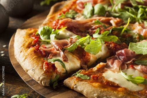 Leinwanddruck Bild Prosciutto and Arugula Pizza