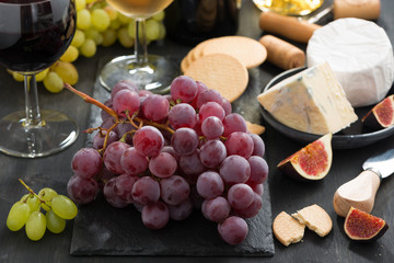 bunch of red grapes, assorted cheeses and appetizers