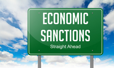 Economic Sanctions on Highway Signpost.