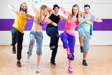 Fototapety Dancer at Zumba fitness training in dance studio