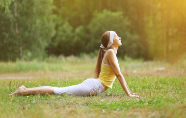 Sport, fitness, yoga - concept, woman doing exercise outdoors