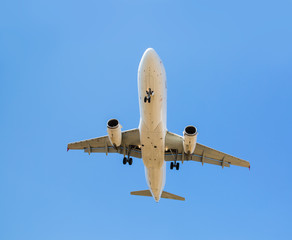 passenger plane fly down over take-off runway from airport